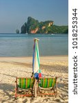 umrella and sunchairs at ao loh ... | Shutterstock . vector #1018253344