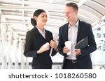 businessman and colleague... | Shutterstock . vector #1018260580