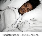 a woman with problem sleeping | Shutterstock . vector #1018278076