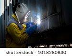 industry worker with welding...   Shutterstock . vector #1018280830