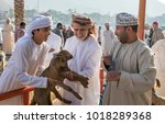 Small photo of nizwa, Oman, Febrary 2nd, 2018: scene from traditional goat auction - two baby goats are being sold to a highest bidder