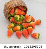 fresh ripe strawberries on a...   Shutterstock . vector #1018295308