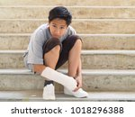 asian boy with broken arm to... | Shutterstock . vector #1018296388