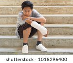 asian boy with broken arm to... | Shutterstock . vector #1018296400