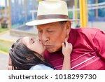 Little Granddaughter Giving A...