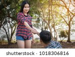 couple hugging in the park. | Shutterstock . vector #1018306816