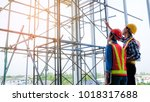 two female engineers and male... | Shutterstock . vector #1018317688