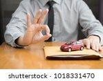 consumer preparing documents... | Shutterstock . vector #1018331470