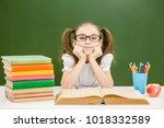 girl with books preparing for... | Shutterstock . vector #1018332589