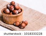 brown hazel nut. healthy... | Shutterstock . vector #1018333228