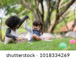 happy mixed race boy and girl ... | Shutterstock . vector #1018334269