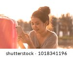 a beautiful tourist woman with... | Shutterstock . vector #1018341196