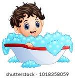 cute little boy taking a bath... | Shutterstock .eps vector #1018358059