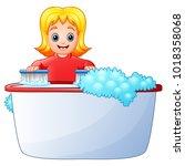 happy girl cleaning bathtub on... | Shutterstock .eps vector #1018358068