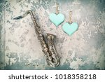 aged retro saxophone handmade... | Shutterstock . vector #1018358218