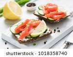 rye bread with smoked salmon ... | Shutterstock . vector #1018358740