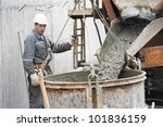 Builder Worker Pouring Concret...