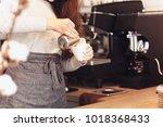 barista  cafe  making coffee ... | Shutterstock . vector #1018368433