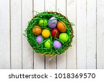wooden background with easter... | Shutterstock . vector #1018369570