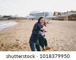young woman playing at sea sand ... | Shutterstock . vector #1018379950
