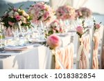 table setting at a luxury... | Shutterstock . vector #1018382854
