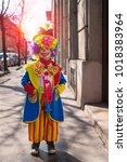 little boy dressed as a clown. | Shutterstock . vector #1018383964