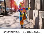 little boy dressed as a clown. | Shutterstock . vector #1018385668