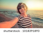 stylish attractive mature woman ... | Shutterstock . vector #1018391893