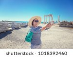mature beautiful woman traveler ... | Shutterstock . vector #1018392460