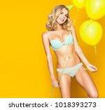 a slender girl in underwear and ... | Shutterstock . vector #1018393273