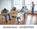 teenagers classroom wirh... | Shutterstock . vector #1018393969
