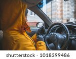 woman drive car in cold winter... | Shutterstock . vector #1018399486