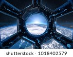 view from a porthole of space... | Shutterstock . vector #1018402579