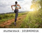 asian young fitness woman... | Shutterstock . vector #1018404016