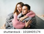cute couple wasting their time... | Shutterstock . vector #1018405174