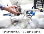 hands plumber at work in a... | Shutterstock . vector #1018414846