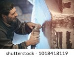 closeup of a worker who... | Shutterstock . vector #1018418119