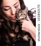Stock photo pretty young woman holding kitten studio portrait 101843170