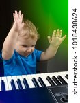 toddler playing the piano | Shutterstock . vector #1018438624