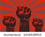three clenched fists raised in... | Shutterstock .eps vector #1018438903