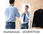 young businessman looking at... | Shutterstock . vector #1018457428