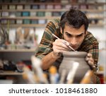 young man making and decorating ... | Shutterstock . vector #1018461880