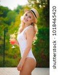 slim fashion model in a... | Shutterstock . vector #1018465420