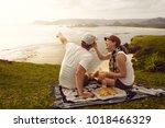 enjoying dinner outdoors....   Shutterstock . vector #1018466329