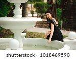 beautiful girl near the... | Shutterstock . vector #1018469590