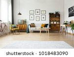 gallery of posters above settee ... | Shutterstock . vector #1018483090