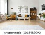 gallery of posters above settee ... | Shutterstock . vector #1018483090