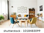 yellow and green armchairs and... | Shutterstock . vector #1018483099