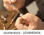 Jeweler working in workshop ...