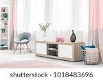 brown vase on wooden cupboard... | Shutterstock . vector #1018483696
